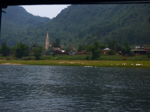 Views from the boat, a church on each side of the river.