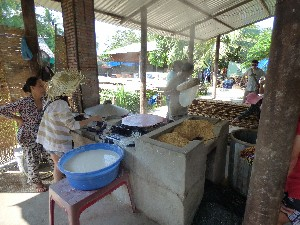 Making the rice paper- the dried rice husks are the fuel to prepare the paper.
