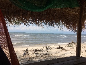 The nice beach apparently- opposite Koh Kong. Stopped here for 30 mins for a juice and a swing in a Hammock- ended up with coke as there were no coconuts apparently.