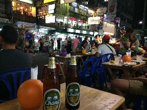 Observing the action on Khao San Road, waiting for food.