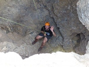 Gav halfway down, having been told to keep both hands on the rope the instructor asked him to wave, so eventually he did..