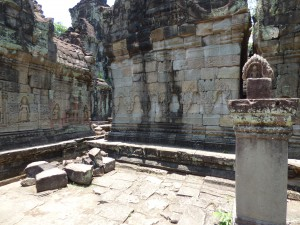 There was a time that the Khmer Kingdom changed from Buddhism to Hinduism before changing back to Buddhism. During the Hindu period the Buddhas were removed from the walls in numerous temples but here is an example from Preah Khan.