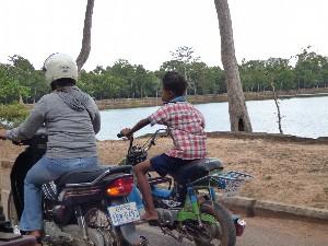 Kid on a motorbike.