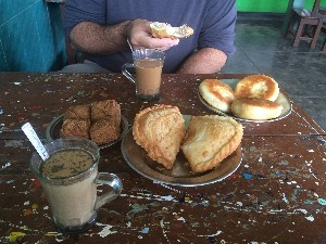 Then a visit to a Muslim Tea shop, Thu Kha, you pay for what you eat. Good tea and coffee. The big ones in the middle had taro in them and the flat ones at the back some sort of bean paste. The ones on the left were like rock buns without the raisins (and a bit hard)- nice though.