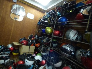 AYA travel's chaotic helmet room.