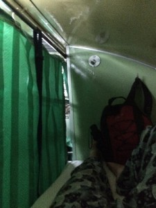 ..we had gone for a fan carriage, it was a bit hot with the curtain closed but too bright with it open, the black strap you can see there was one of two and was infinitely more comfortable than the train in Yangon,, we actually got some sleep!