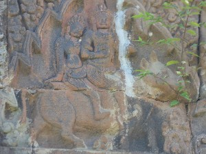 Carving of Shiva and his wife Parvati riding Nandi over an entrance..