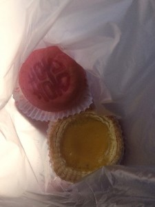 "There was a little Chinese bakery opposite where we got a egg tart and this little pink bun called a ""Wedding Cake""."